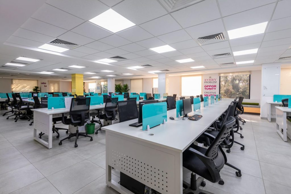 A photo showing a fully furnished office space with workstations
